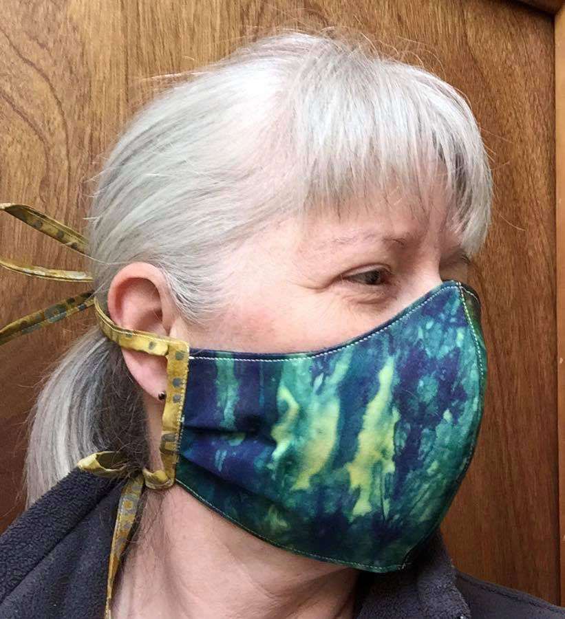Side View of Women wearing Face Mask.
